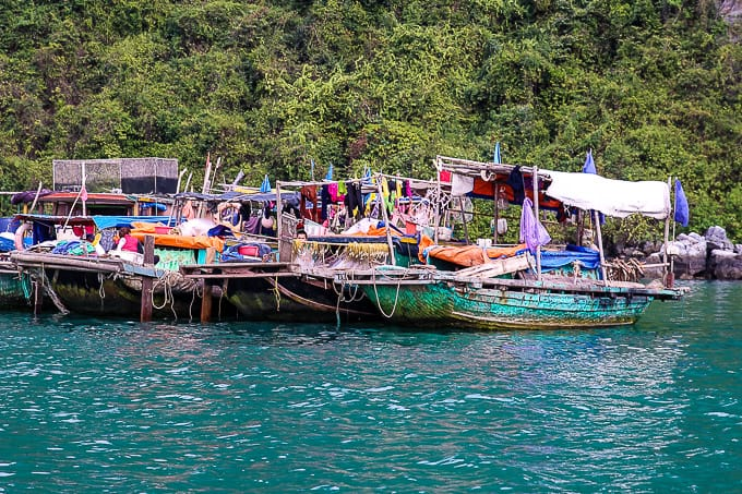 local fishing boats on Ha Long Bay, Vietnam