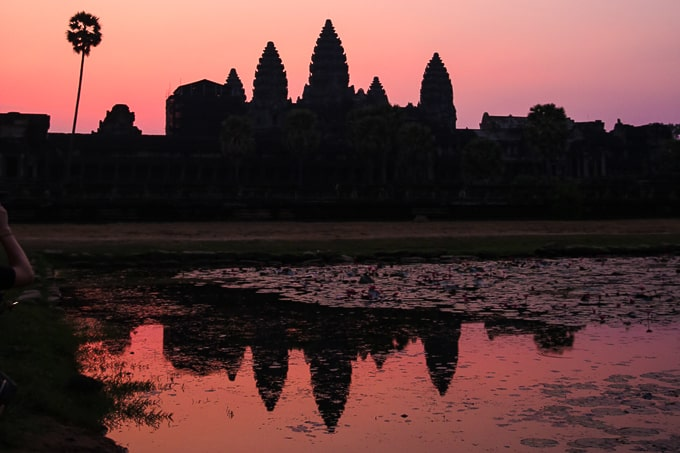Angkor Wat reflecting in the pond at sunrise
