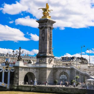 Socles crowned by gilded Fames sculptures - Pont Alexandre III - Bridge over the Seine, France