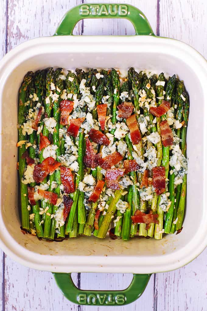 roasted asparagus with blue cheese and bacon in a baking dish