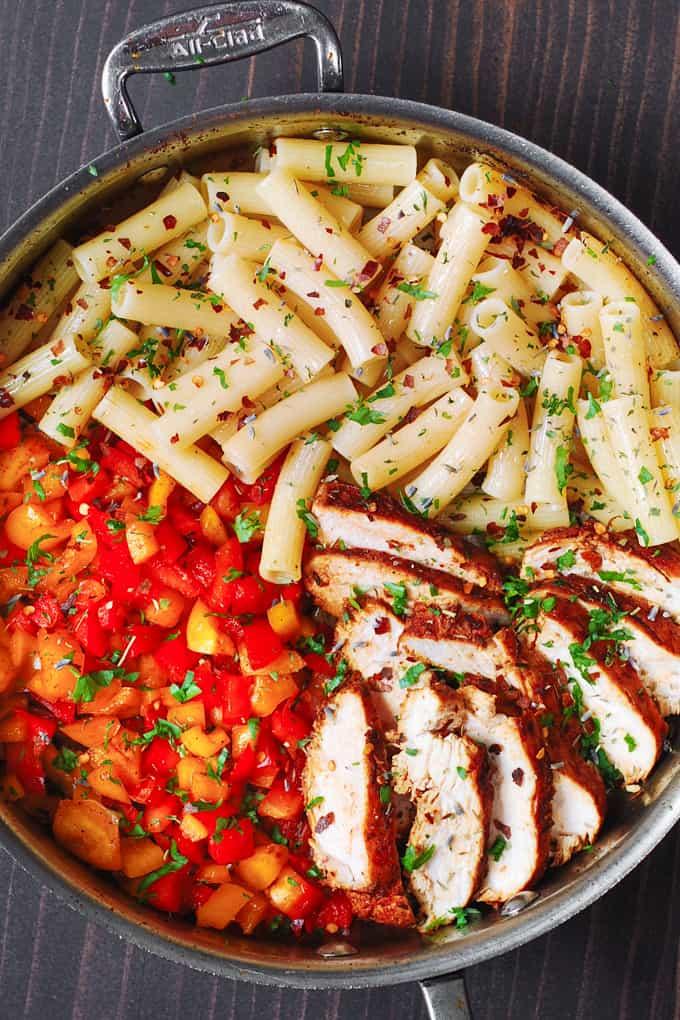Creamy and spicy Cajun Chicken Pasta with Bell Peppers and homemade Cajun seasoning in a stainless steel skillet