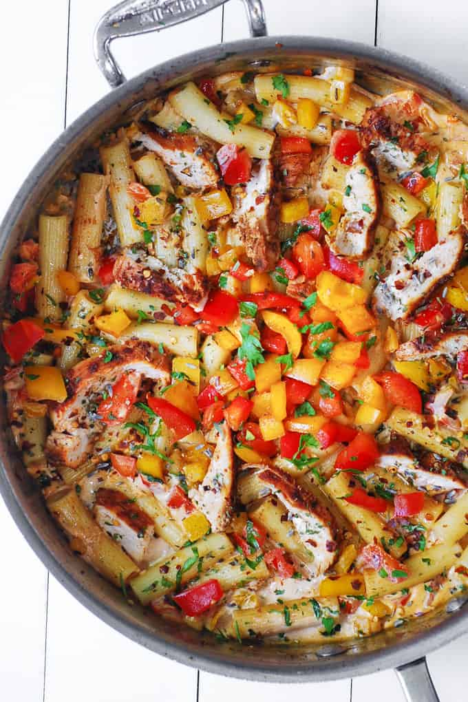 Creamy and spicy Cajun Chicken Pasta with Bell Peppers in a large stainless steel skillet