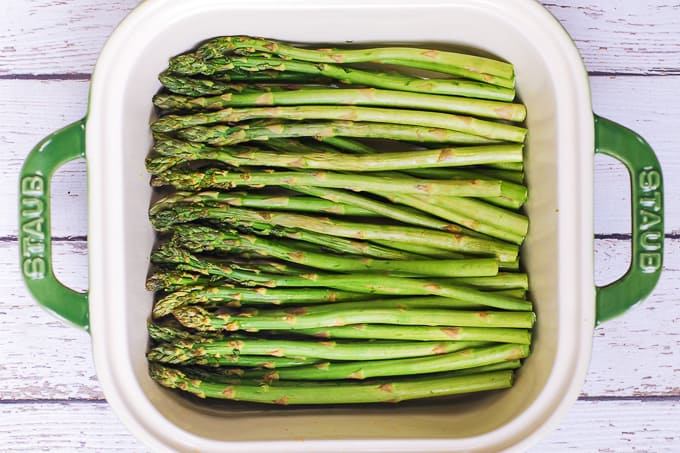 trimmed asparagus in a baking dish