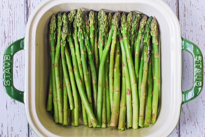 Trimmed fresh asparagus in a casserole dish