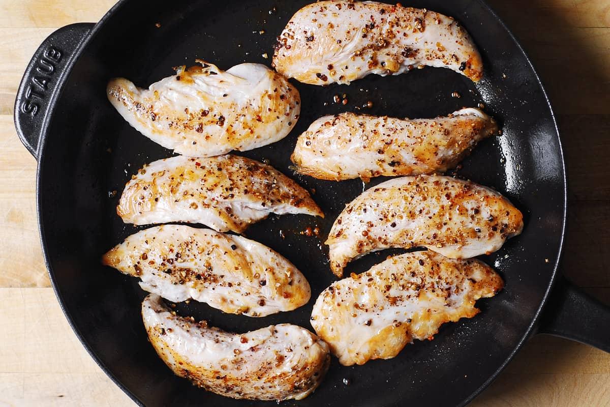 seared chicken tenderloins in a cast-iron skillet