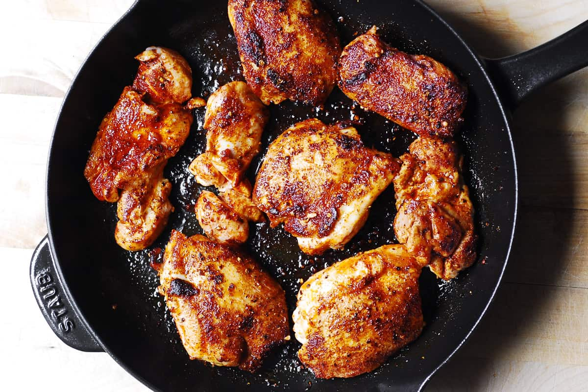 seared chicken thighs in a cast-iron skillet