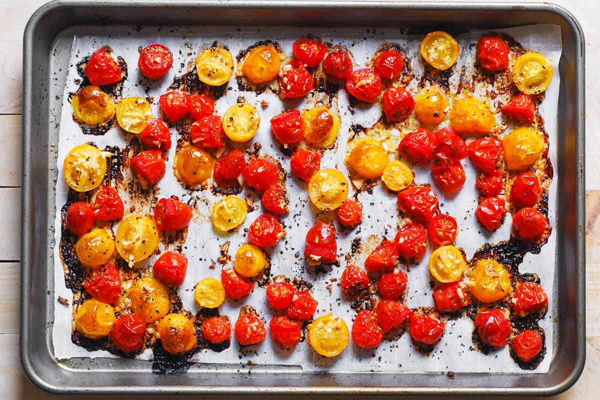 roasted sliced cherry tomatoes on a baking sheet