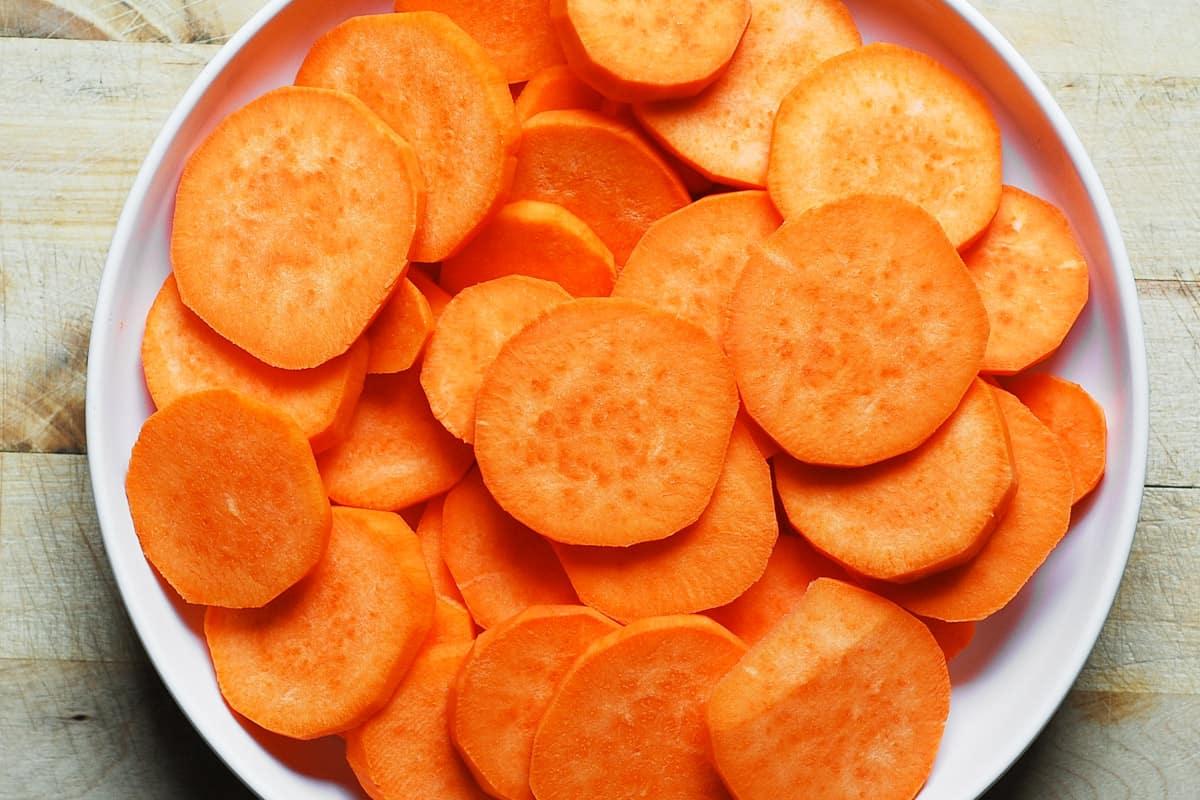 sliced sweet potatoes on a white plate