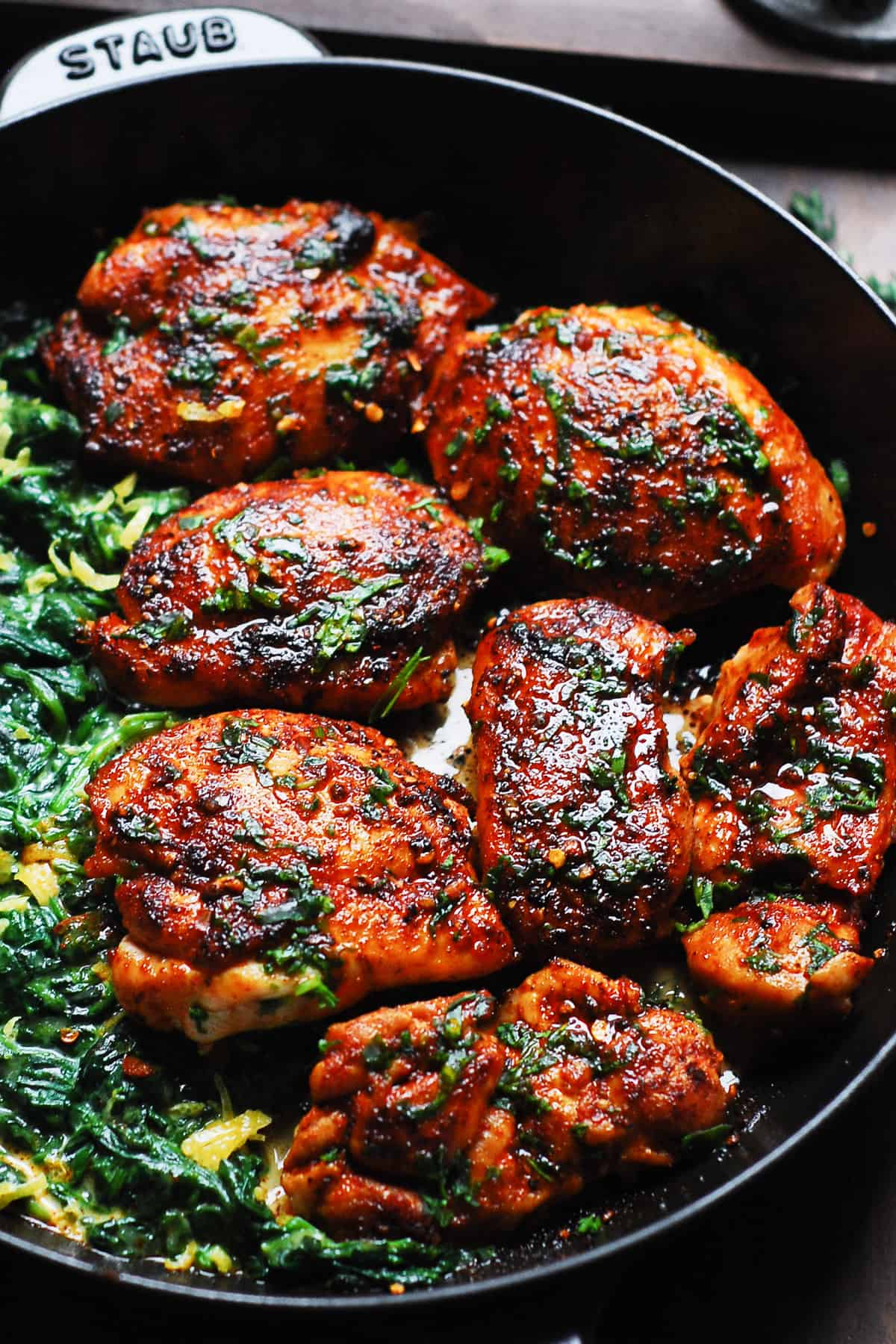 smoked paprika chicken with creamed spinach in a cast-iron skillet