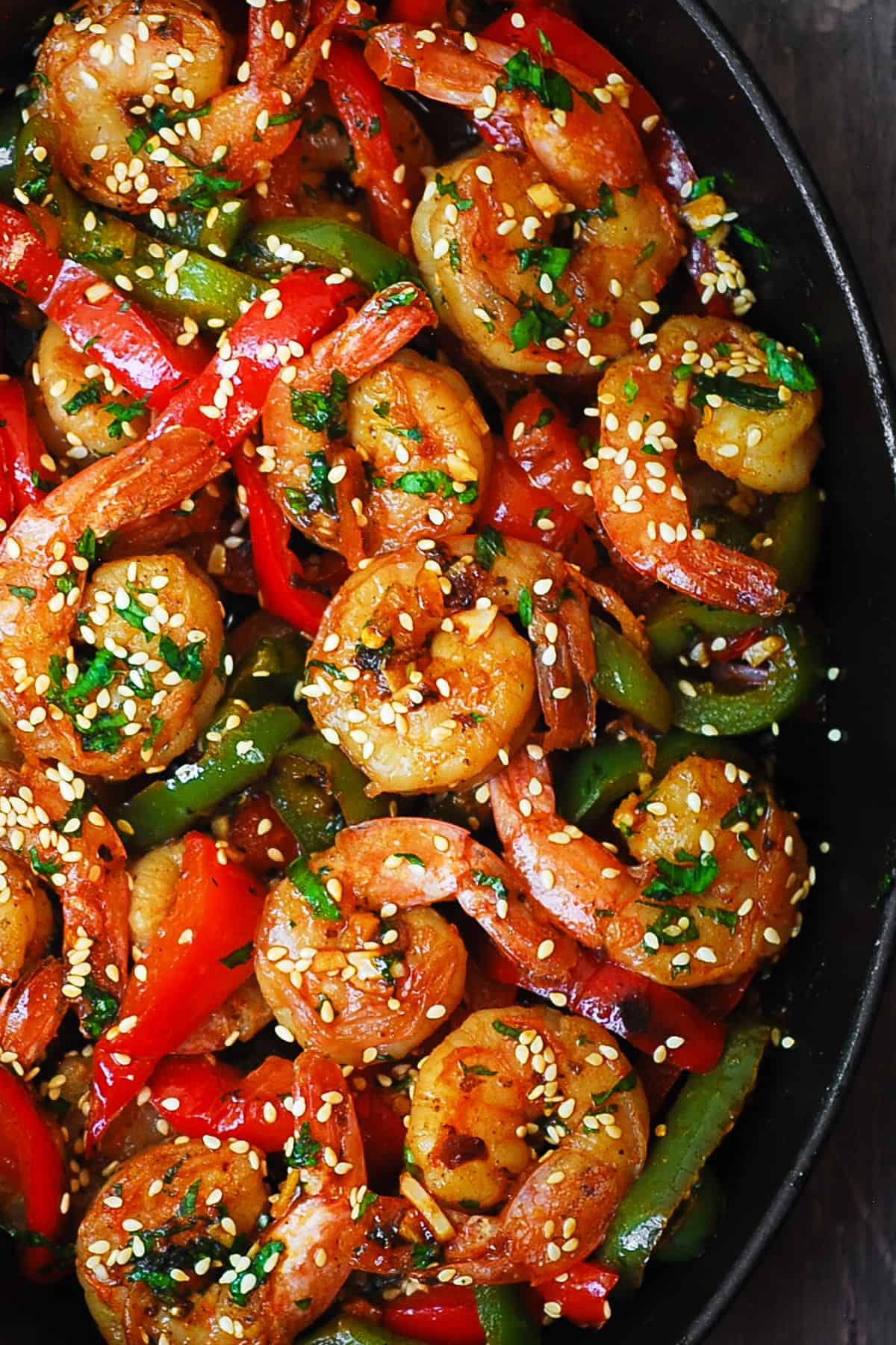 sweet chili shrimp with bell peppers in a cast iron skillet