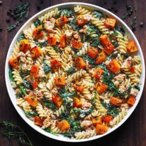 Creamy Ground Turkey Pasta with Butternut Squash and Spinach on a white plate