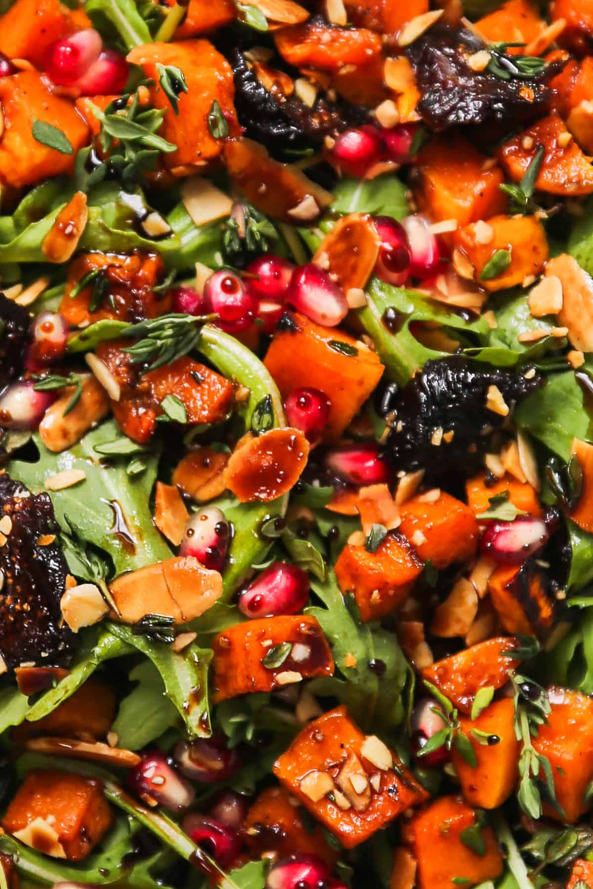 close-up of Fall Salad with Butternut Squash, Arugula, Dried Figs, and Almonds