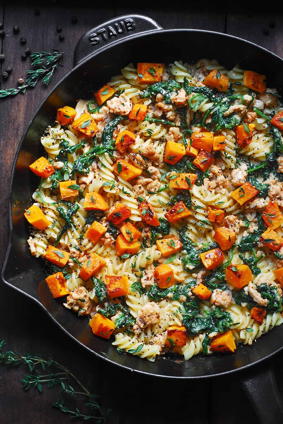 Ground Turkey Pasta with Butternut Squash and Spinach in a cast-iron skillet